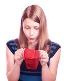 Muchacha adolescente que mira en cosmetólogo Fotos de archivo libres de regalías