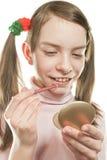 Muchacha adolescente que mira en el espejo Fotografía de archivo libre de regalías