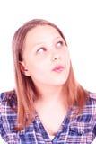 Muchacha adolescente que mira para arriba y que piensa Imagen de archivo