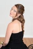 Muchacha adolescente que mira sobre hombro Fotografía de archivo libre de regalías