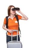Muchacha adolescente que mira a través de los prismáticos Imágenes de archivo libres de regalías