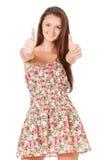 Muchacha adolescente que muestra los pulgares Fotografía de archivo