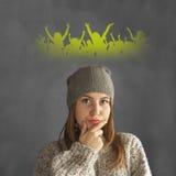 Muchacha adolescente que piensa en un partido Imagen de archivo libre de regalías