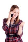 Muchacha adolescente que ríe y que habla en el teléfono Fotos de archivo