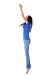 Muchacha adolescente que salta en aire. Fotos de archivo