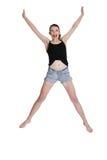 Muchacha adolescente que salta para la alegría Imágenes de archivo libres de regalías