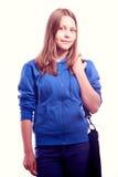 Muchacha adolescente que se coloca con la cartera Foto de archivo libre de regalías