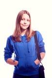 Muchacha adolescente que se coloca con la cartera Foto de archivo