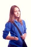 Muchacha adolescente que se coloca con la cartera Fotos de archivo