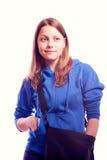 Muchacha adolescente que se coloca con la cartera Fotografía de archivo libre de regalías