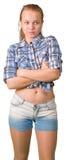Muchacha adolescente que se coloca con las manos cruzadas Fotografía de archivo libre de regalías
