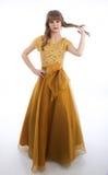 Muchacha adolescente que se coloca en vestido formal del baile de fin de curso Imágenes de archivo libres de regalías