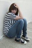 Muchacha adolescente que siente sola y deprimida Fotografía de archivo libre de regalías
