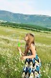 Muchacha adolescente que sopla Fotografía de archivo libre de regalías