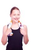 Muchacha adolescente que sostiene la toalla y la botella de agua Fotos de archivo