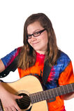 Muchacha adolescente que toca la guitarra Imágenes de archivo libres de regalías