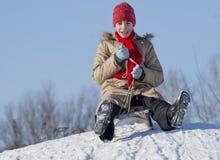 Muchacha adolescente sledding Fotografía de archivo