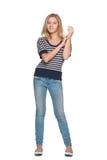 Muchacha adolescente sonriente contra el blanco Imágenes de archivo libres de regalías