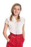 Muchacha adolescente sonriente contra el blanco Imagen de archivo libre de regalías