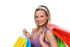 Muchacha adolescente sonriente de Beautitul con los bolsos de compras Foto de archivo
