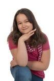 Muchacha adolescente sonriente en color de rosa Fotografía de archivo libre de regalías