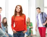 Muchacha adolescente sonriente en la escuela Fotos de archivo libres de regalías