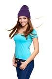 Muchacha adolescente sonriente que se coloca en sombrero Foto de archivo libre de regalías
