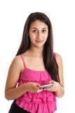 Muchacha adolescente texting Fotos de archivo