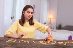 Muchacha adolescente tranquila que sufre de bulimia Foto de archivo libre de regalías