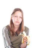 Muchacha adolescente triste con el plátano Imagenes de archivo