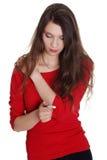 Muchacha adolescente triste que controla la prueba embarazada Imagen de archivo