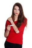 Muchacha adolescente triste que controla la prueba embarazada Imagenes de archivo