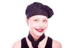Muchacha adolescente vestida en sombrero del cocinero Imagen de archivo