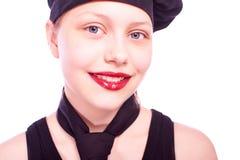 Muchacha adolescente vestida en sombrero del cocinero Imagen de archivo libre de regalías