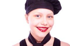 Muchacha adolescente vestida en sombrero del cocinero Fotografía de archivo libre de regalías