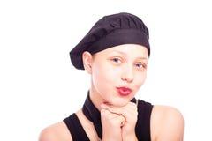 Muchacha adolescente vestida en sombrero del cocinero Foto de archivo