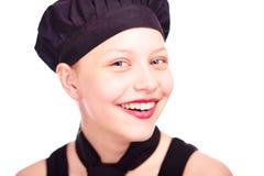 Muchacha adolescente vestida en sombrero del cocinero Fotos de archivo libres de regalías