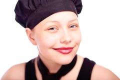 Muchacha adolescente vestida en sombrero del cocinero Foto de archivo libre de regalías