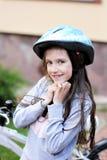 Muchacha adorable del niño en casco azul Foto de archivo libre de regalías