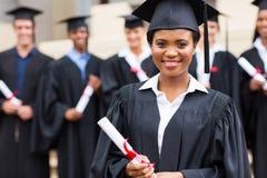 Muchacha africana joven en la graduación Fotos de archivo libres de regalías