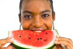 Muchacha africana que come una sandía Imagen de archivo libre de regalías