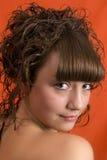 Muchacha agradable con el pelo rizado Imagen de archivo