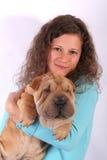 Muchacha agradable con el perro Foto de archivo