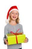 Muchacha agradable con el regalo de Navidad imagen de archivo