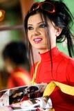 Muchacha agradable con sonrisa en camiseta roja Imagen de archivo