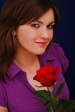 Muchacha agradable con una rosa Fotos de archivo