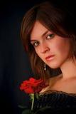 Muchacha agradable con una rosa Fotografía de archivo