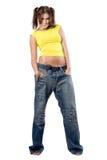 Muchacha agradable joven en pantalones vaqueros Fotografía de archivo