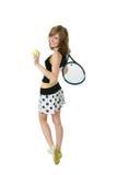 Muchacha agradable que sostiene una raqueta de tenis Fotografía de archivo