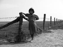 Muchacha al lado de la cerca Foto de archivo